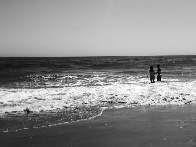 Let's Go Together Simple Pleasures In Life Horizon Over Water Lifestyles Beauty In Nature Vacations Clear Sky Wave Sand Black & White Bnw_collection EyeEmBestPics Simplicity A Week On Eyeem Shootermag Pupolar Photos Capture The Moment Eye4photography  EyeEm Gallery EyeEm Nature Collection Water_collection Under The Sun Outdoors EyeEm Nature Lover Togetherness