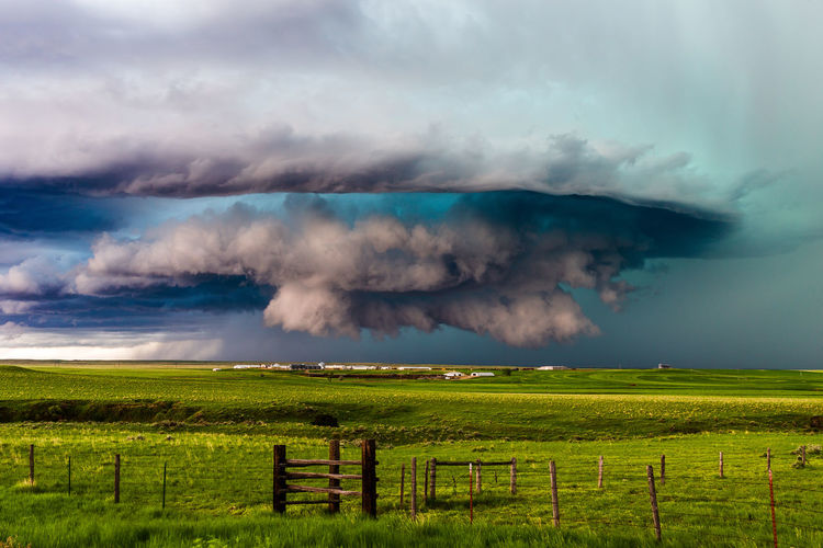 A dramatic supercell thunderstorm spins across the rolling grasslands near Ryegate, Montana. Supercell Thunderstorm Storm Storm Cloud Cloud - Sky Sky Wall Cloud Hailstorm Dramatic Sky Stormy Sky Stormy Weather Severe Weather Weather Scenics - Nature Grass Landscape Field Beauty In Nature Nature Green Color Power In Nature Non-urban Scene Montana Ominous Background