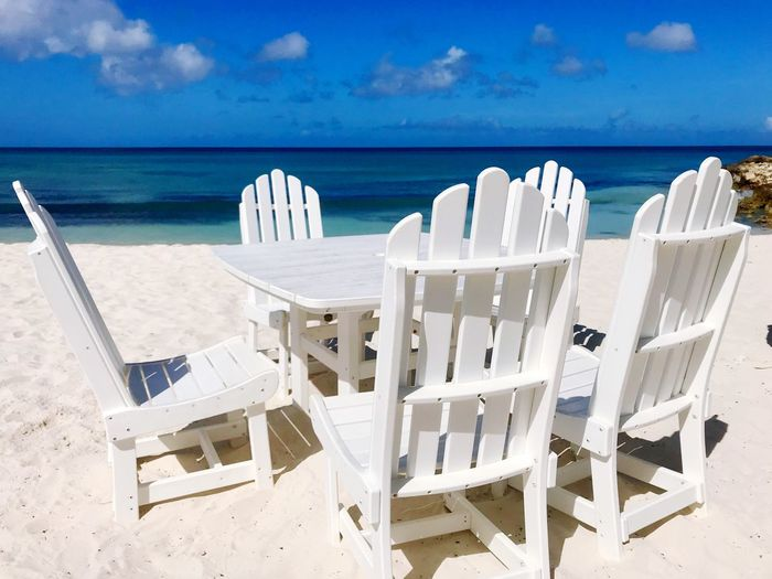 Idyllic Paradise Tropical Antilles Island Dutch Caribbean Caribbean Beach Sea Chair Sand Horizon Over Water White Color Beauty In Nature Shore Relaxation Tranquil Scene Sky Water Nature Tranquility Summer Day Outdoors No People Table Seat