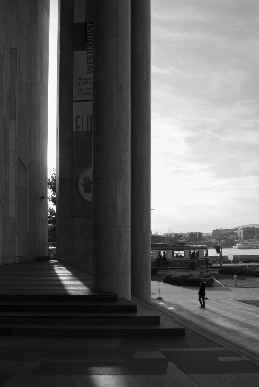 architecture, architectural column, built structure, transportation, day, sky, travel, real people, men, sunlight, airport, two people, building exterior, outdoors, people