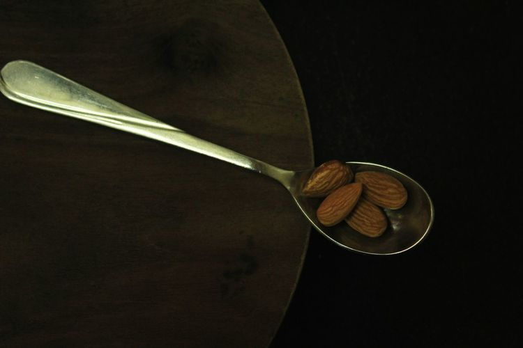 No People Wood - Material Studio Shot Indoors  Black Background Close-up Day Almonds Healthy Eating Nut - Food Food Spoonfull Colored Background Brown Background Wooden Table Freshness Eating Calories Spoonful Almond Dry Fruit Energy High Angle View Spoon Food And Drink