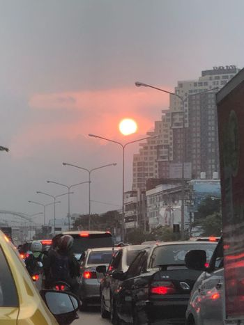 Live bye Liza die in Bangkok Car Motor Vehicle Mode Of Transportation Transportation City Land Vehicle Sky Sunset Street Architecture Built Structure Traffic Building Exterior Road Nature No People Sun Street Light Traffic Jam Orange Color