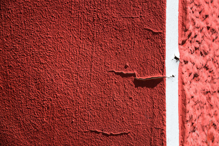 Close-up Of Cracked Red Wall