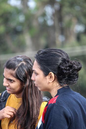 Female friends looking away
