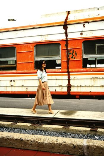 Full length of woman with train at railroad station