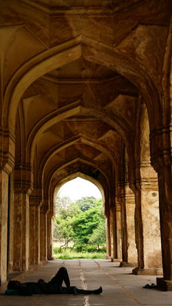 The beauty of Loneliness Arch Architecture History Built Structure Architectural Column Travel Destinations Day No People Indoors  One Adult Man Sleeping Man No Filter, No Edit, Just Photography Sony Alpha A6000 Sony Alpha Eyeem Architecture Outdoors Eyeem Architecture Lover Eyeem Monuments Hyderabad Monuments Qutub Shahi Tombs EyeEm Historical Indian Monuments