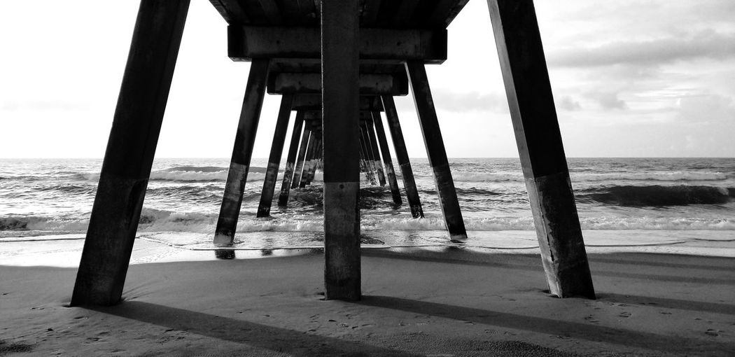Under Johnny Mercer's Pier Note 8 Note 8 Photography No People NC NCPhotographer Ncphotography Wrightsville Beach Wrightsvillebeachnc Beach Beachphotography Water Sea Beach Sand Sky Horizon Over Water Underneath Below Under Shore Sandy Beach Ocean Surf Pier Tranquil Scene Wave Tranquility Calm