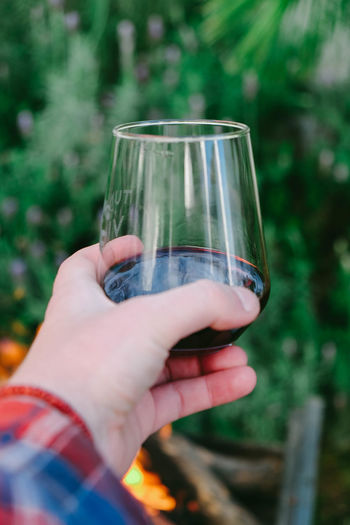 Sunday Bloody Sunday Close-up Day Fire Focus On Foreground Glass Holding Human Finger Leisure Activity Lifestyles Nature Outdoors Part Of Person Personal Perspective Red Selective Focus Unrecognizable Person Wine Wineglass Wine Moments