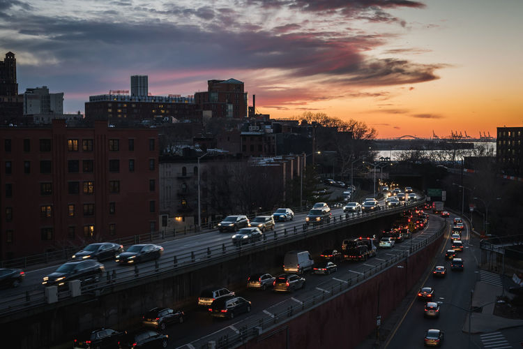 Colorful sunset on the brooklyn queens expy highway between brooklyn and manhattan in ny