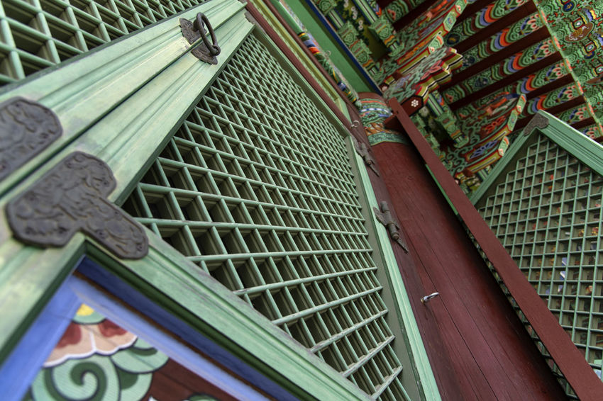view of Bomunsa, a famous Buddhism temple at Seokmodo in Ganghwado, Kimpo, Gyeeonggido, South Korea Bomunsa Buddhism Temple Seokmodo Architecture Art And Craft Buddhism Building Built Structure Close-up Communication Day Design Ganghwado Green Color High Angle View Indoors  Metal Multi Colored No People Pattern Railing Religion Religious  Temple Tilt Wood - Material