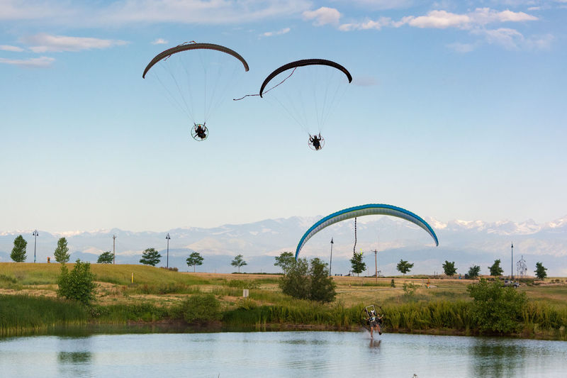 Powered Paragliders Activity Adventure Cloud - Sky Day Flying Fun Hangglider Leisure Activity Mid-air Outdoors Paragliding Powered Paraglider Sky Sport Unrecognizable Person