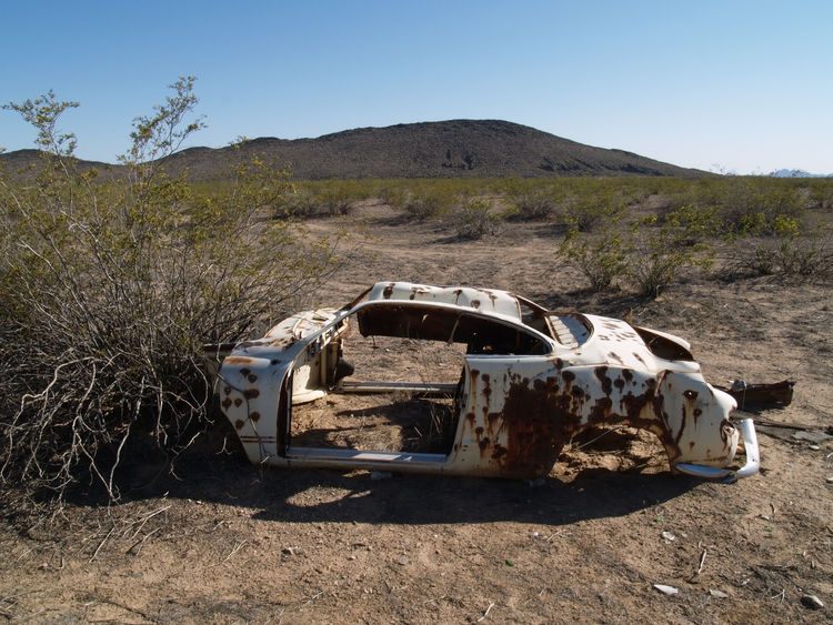 The rusting shell of an old car in a remote area of the Arizona desert. Arizona Automobile Junk Cars Abandoned Car Car Clear Sky Day Landscape Mountain Nature No People Old Outdoors Rusting Sky Transportation Tree Wrecked Car