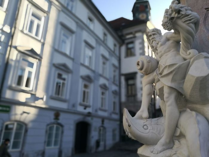 Architecture Building Exterior Built Structure Low Angle View No People Outdoors Residential Building City Day Close-up Building Feature Ljubljana Robbov Vodnjak Statue Slovenia The City Light