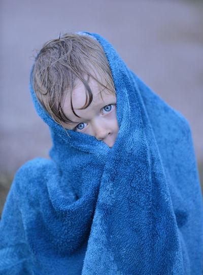 Portrait Of Boy Wrapped In Blue Towel
