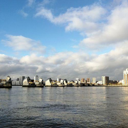 Sea against buildings in city