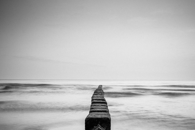 Stone Pier On Sea Against Clear Sky