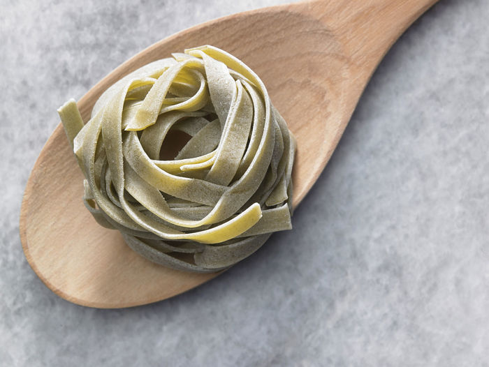 tagliatelle pasta Cooking Dried Food Food And Drink Noodles Shape Spoon Tagliatelle Textured  Wheat Carbohydrate - Food Type Close-up Directly Above Food Freshness High Angle View Indoors  Ingredient Italian Food No People Nutrition Pasta Product Raw Food Still Life Table