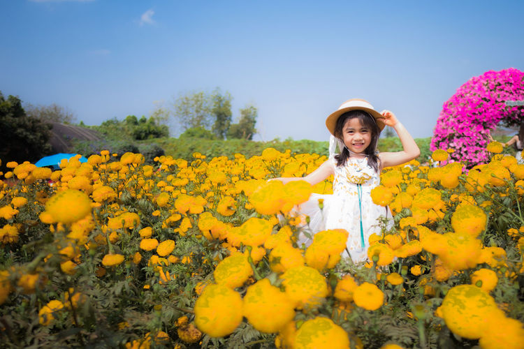 Portrait of girl with yellow flowers
