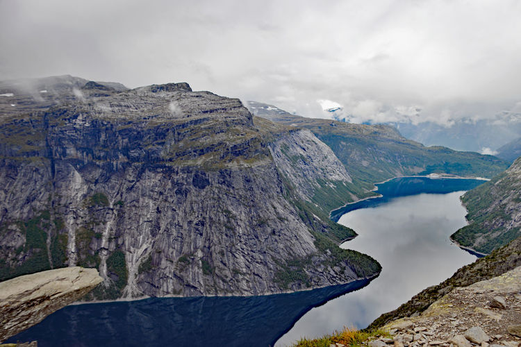 View from Trolltunga Norway Beauty In Nature Cloud - Sky Day Environment Formation Idyllic Lake Mountain Mountain Peak Mountain Range Nature No People Non-urban Scene Outdoors Physical Geography Rock Rock - Object Scenics - Nature Sky Tranquil Scene Tranquility Trolltunga Norway Hiking Water
