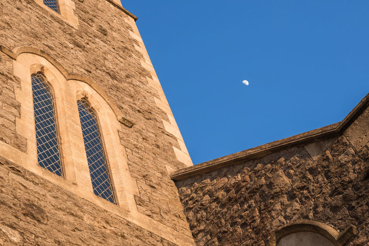 Playing with composition and angles. Architecture_collection Church Lines Angles Architecture Blue Building Exterior Built Structure Canon Clear Sky Day Low Angle View Moon Nature No People Outdoors Sky Stone Uk