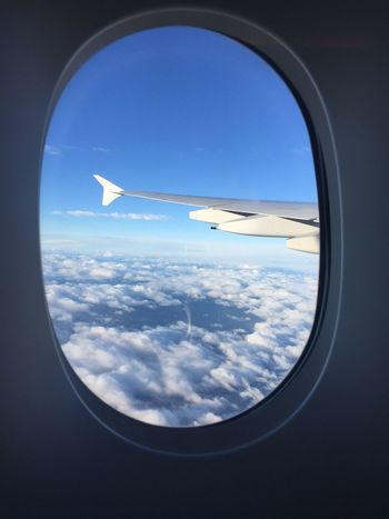 Airplane Window Transportation Travel Journey Mode Of Transport Flying Vehicle Interior Sky Aircraft Wing Air Vehicle Looking Through Window Indoors  Aeroplane Day Cloud - Sky Airplane Wing No People Nature EyeEmNewHere Light