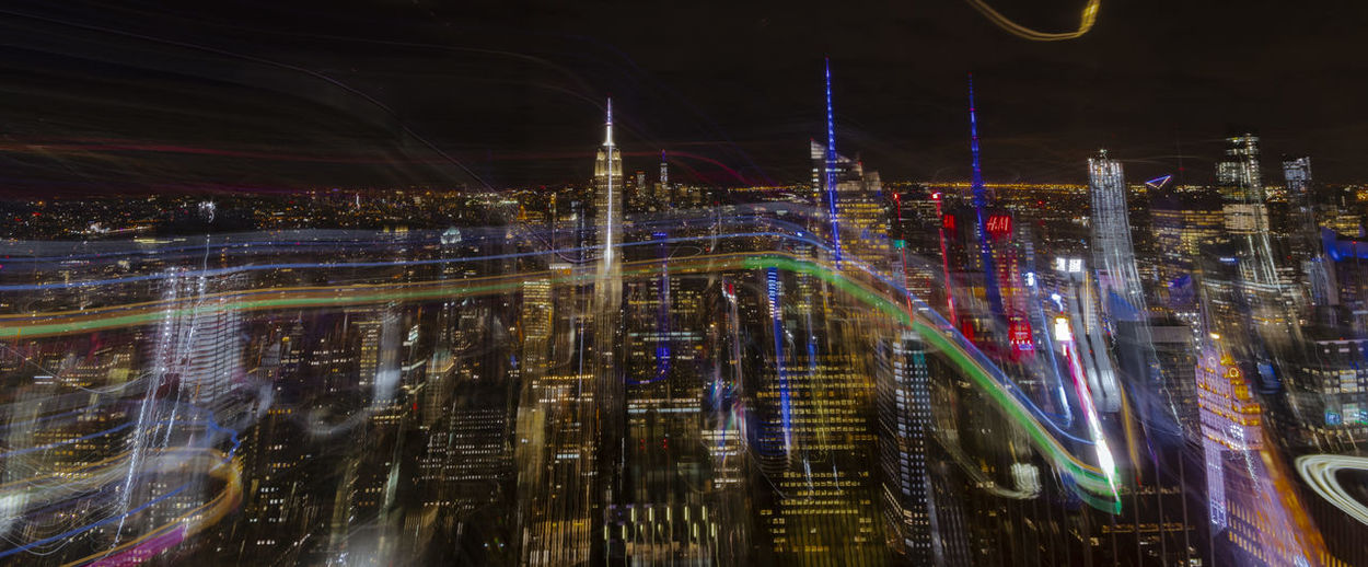 blurred cityligths from abovehttps://www.youtube.com/watch?v=AR6mAPTaoVQ Futuristic Architecture Manhattan Skyline Manhattan Nightlights Nightphotography EyeEm Gallery Colorful Edited My Way Exceptional Photographs Modern Glowing Multi Colored Built Structure Night City Long Exposure Illuminated Light Trail Motion Architecture Blurred Motion Light Skyscraper City Life Cityscape Lighting Equipment