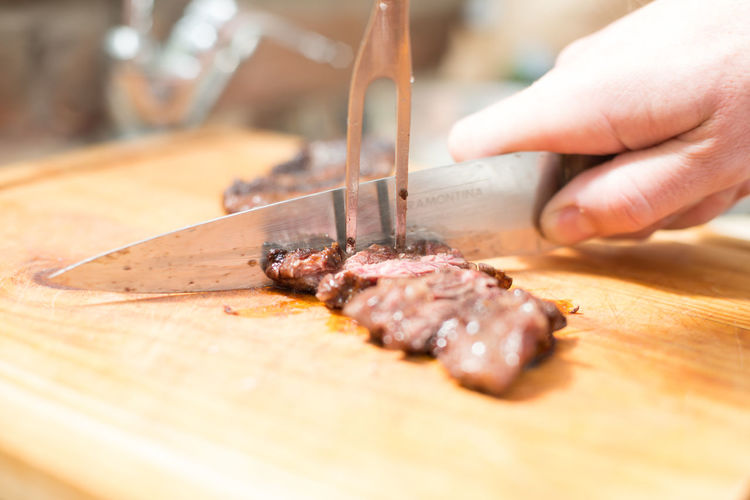 """Lomo Liso"" or cow smooth is a typical chilean meat on the 2018 Asado Eating Food Table Loin Meat! Meat! Meat! Asado Argentino Barbecue Barbecue Grill Close-up Cutted Meat Cutting Board Food Food And Drink Food Porn Freshness Human Hand Lomo Meat Meat Love Meat Table Preparation  Preparing Food Selective Focus Table Wood - Material"