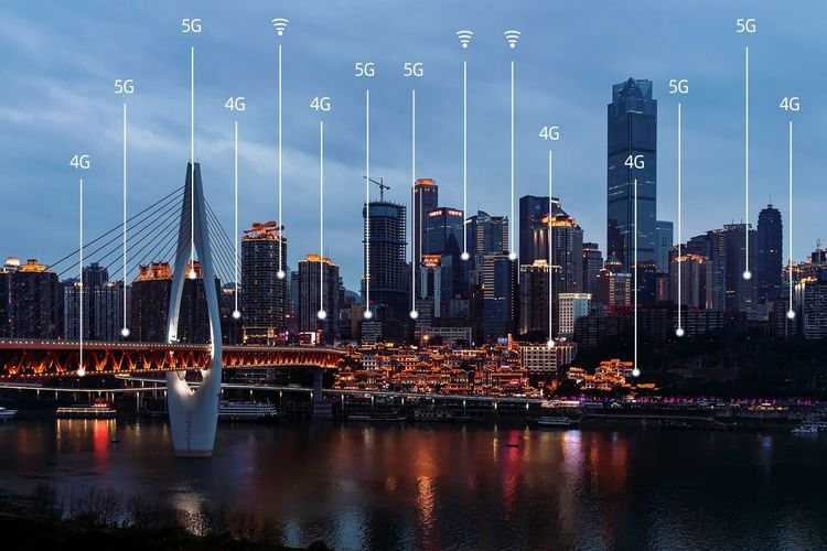 Digital composite image of illuminated buildings against sky