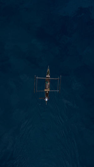 Aerial view of outrigger in sea