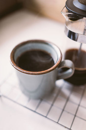 Close-up of coffee mug on table