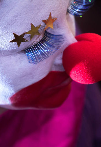 Close-Up Of Woman With Face Paint And Clown