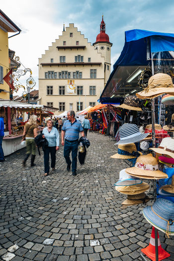Architecture Building Exterior Built Structure Casual Clothing City City Life Cobblestone Day Leisure Activity Lifestyles Market Market Stall Markt Mixed Age Range Multi Colored Outdoors Retail  Sky Sursee Surseer Warenmarkt Town Warenmarkt