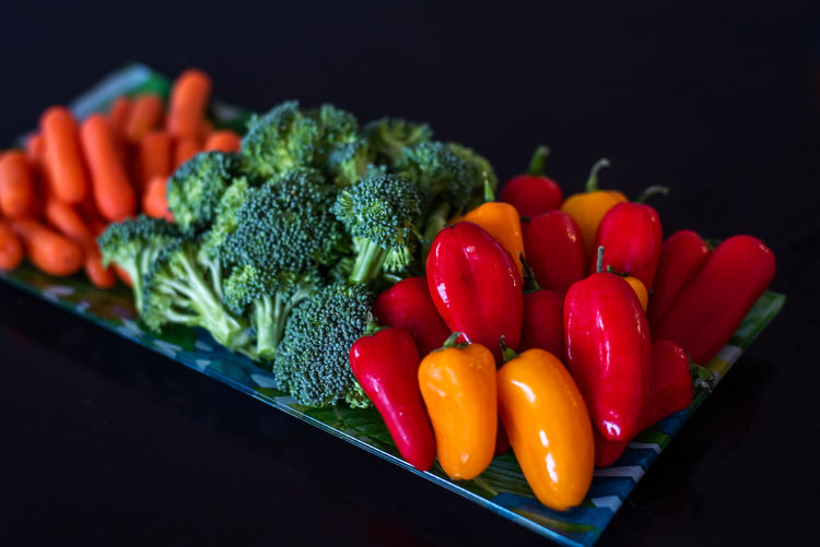 Vegetable Food And Drink Freshness Food Wellbeing Healthy Eating Red Broccoli Still Life Indoors  Pepper Close-up Bell Pepper Green Color Choice Green Raw Food No People Black Background Large Group Of Objects Chopped Tray Salad
