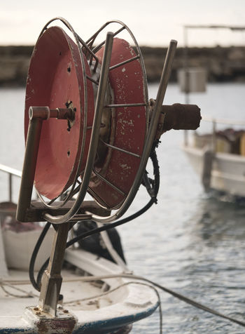 Fishing reel Fishing, Fishing Boat, Fishing Reel, Fisherman Close-up Day Focus On Foreground Metal Mode Of Transport Nautical Vessel No People Old-fashioned Outdoors River Transportation Water