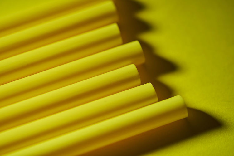Full frame shot of yellow pencils on table