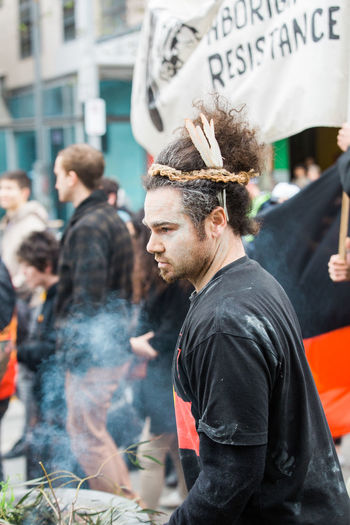MELBOURNE/AUSTRALIA - 30 JULY , 2016: Protesters rally against the torture and detention of indigenous children in the Northern Territory. The rally was held outside the State Library. Aboriginals Day Indiginous Leisure Activity Lifestyles Outdoors Protest Protesters Racist Rally