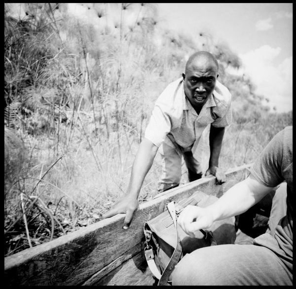 The ferry man of Bussi Island Africa Analogue Photography Black And White Boat Bussi Island Clay East Africa Entebbe Ferry Ferryman Film Photography Filter Production Grain Machete Medium Format Outdoors Portrait Social Business Summer The Photojournalist - 2017 EyeEm Awards Uganda  Victoria Lake Water