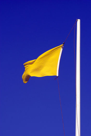Architecture Blue Blue Background Built Structure Clear Sky Close-up Copy Space Cropped Day Low Angle View Multi Colored Nature No People Outdoors Part Of Pole Sky Sunlight Vapor Trail Yellow Yellow Flag