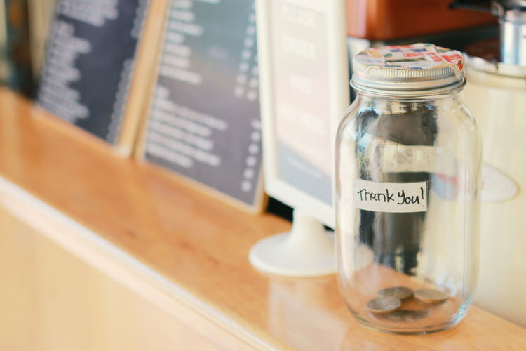 Close-up of glass jar on table at restaurant