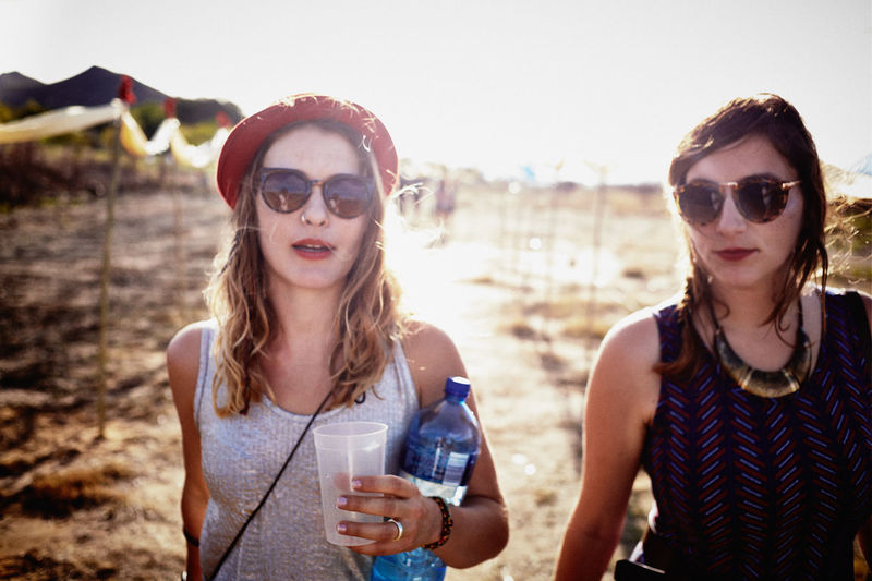 Adult Adults Only Beach Clear Sky Day Focus On Foreground Friendship Front View Happiness Headshot Leisure Activity Looking At Camera Outdoors People Portrait Real People Sky Sunglasses Sunlight Togetherness Two People Vacations Water Young Adult Young Women