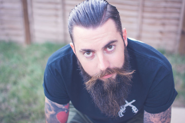 Portrait of bearded man with tattoos