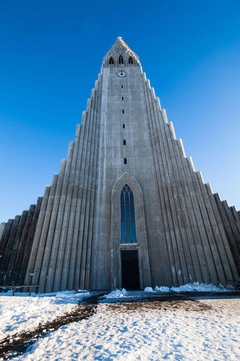 Hallgrimskirkja is a Lutheran parish church cathedral in Reykjavik, Iceland. Architecture Sky Built Structure Building Exterior Nature Travel Destinations Cold Temperature Snow Clear Sky Winter Hallgrìmskirkja HALLGRÍMSKIRKJA CHURCH Hallgrimskirkjachurch Hallgrimskirkja; Hallgrìmskirkja Lutheran Lutheran Church Low Angle View Day Blue No People Building History The Past Outdoors Sunlight Ancient Civilization