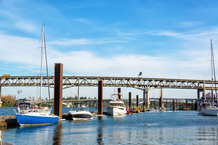PORTLAND, OR - APRIL 8: Riverplace Marina with the Marquam Bridge in the background in Portland, OR on April 8, 2016 Architecture Bridge Bridge - Man Made Structure Built Structure City Day Downtown Marquam Bridge Nautical Vessel Oregon Outdoors Pacific Northwest  Portland River Sky Tourism Transportation Travel Travel Destinations Urban USA Water Waterfront Willamette Willamette River