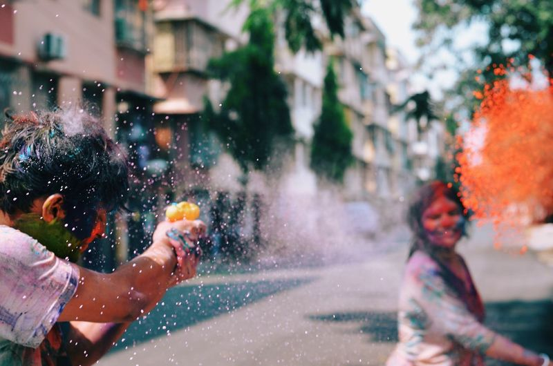 People throwing powder paint