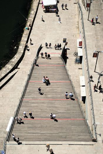 High angle view of people on staircase during sunny day