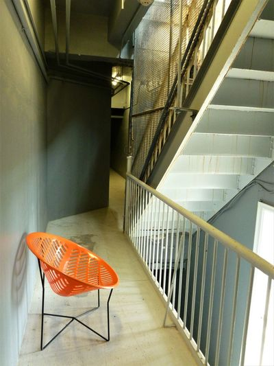 ARCHITECTURAL CHAIR Art Photography INTERESTING SCENE Industrial Photography Metal Frame POWERFUL LINES Architecture Building Fire Escape Built Structure Chair Hand Rail Indoors  No People Orange Chair Railing Staircase Steps Steps And Staircases A New Perspective On Life
