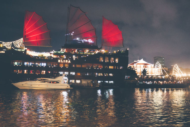 Passenger liner At Night In Vietnam. Vietnam Architecture Boat Building Exterior Business City Cloud - Sky Cruise Line Harbor Illuminated Mode Of Transportation Nature Nautical Vessel Night Outdoors Passenger Craft Passenger Liner Reflection River Sailboat Ship Sky Transportation Water Waterfront