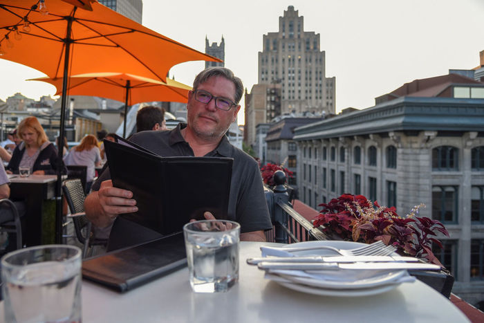 Cityscape Dinner Man Menu Montréal Rooftop Travel Al Fresco Architecture Building Exterior Cafe Canada City Dining Table Food And Drink Lifestyles Outdoors People Real People Restaurant Table Tourism Urban