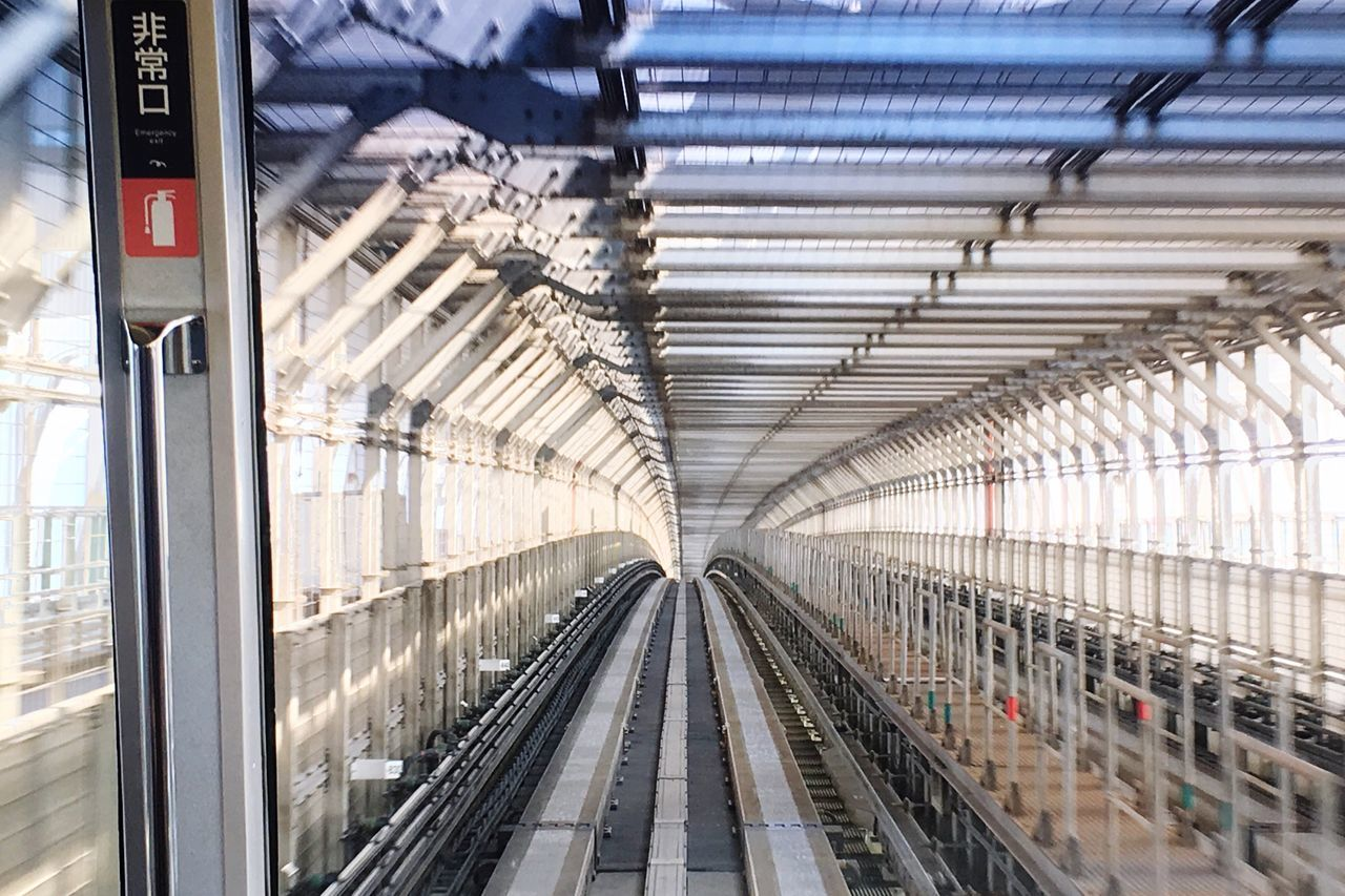 Railroad Tracks Seen Through Train Windshield At Subway Station