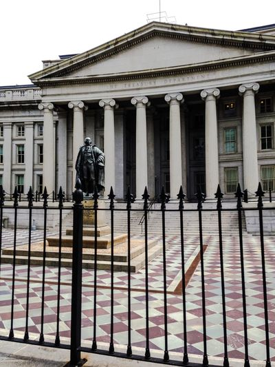 The US Treasury Building. Alexander Hamilton Architectural Column Architectural Feature Architecture Building Exterior Built Structure Checker Tile Column Day Exterior Façade Famous Place Fence In A Row Ornate Outdoors Sky Tourism Travel Destinations US Treasury